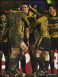 Burgess is mobbed by his team-mates after his match-winning try against Saints