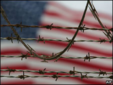 An American flag flies behind barbed wire at Guantanamo Bay prison camp (file image)