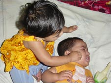 Nayeem Hossain with twin Monica