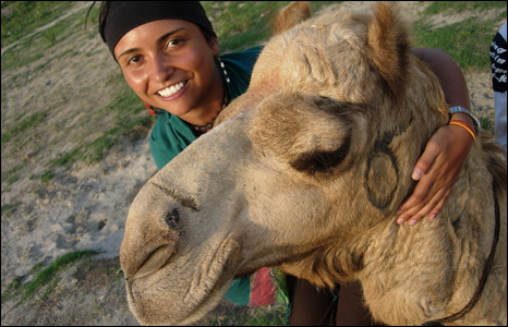 Beautiful woman and camel