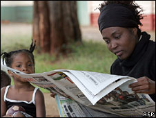 Woman reading a paper in Harare