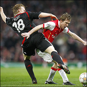 Liverpool's Dirk Kuyt challenges Alexander Hleb