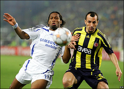 Didier Drogba and Fenerbahce's Luis Edu Dracena battle for the ball