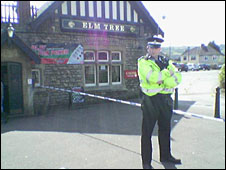 Police officer outside the Elm Tree pub