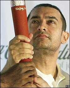 Aamir Khan with a replica of the Olympic torch