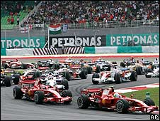 The Ferraris of Felipe Massa and Kimi Raikkonen lead the field at the start of the 2007 Malaysian Grand Prix