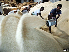 Indian workers prepare rice for packing near Hyderabad, 3 April 2008