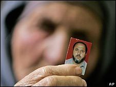 Relative holds up photo of Majed Barghouti