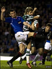 Rangers midfielder Lee McCulloch (left) tussles with Miguel Veloso in the Sporting box