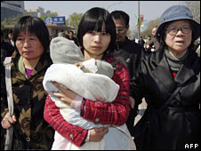 Zeng Jinyan (C) flanked by her mother (L) and Hu Jia's mother (R) outside the court on 3 April 2008