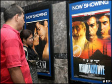 A couple in Delhi looks at the poster of Khuda Kay Liye