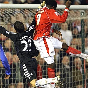 Kayode Odejayi outjumps Carlo Cudicini to score Barnsley's winner in the FA Cup quarter-final against Chelsea