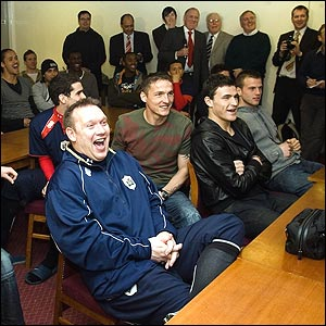 Barnsley's management, players and staff watch the draw for the FA Cup semi-finals