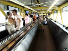 Passengers on a moving walkway