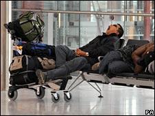 Passenger waits and yawns at Terminal 5