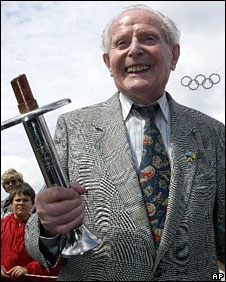 Siegfried Eifrig with the Olympic torch he carried for the 1936 Olympic Games in 1936, Berlin, June 2004