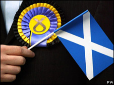 A Scottish flag and Scottish National Party rosette