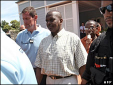 Mohamed Bacar (centre) outside court on the French Indian Ocean island of Reunion, 2 April, 2008