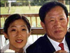 Ran Chen (L), her father Wo Weihan at a wedding