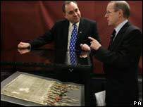 Alex Salmond, First Minister of Scotland (left) and George MacKenzie, Keeper of the Records and Head of the National Archives of Scotland, view the original Declaration of Arbroath.