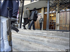 An armed man guards the entrance to a Baghdad church, 3 February, 2008