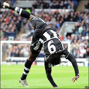 Martins celebrates scoring the opening goal for Newcastle