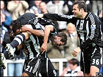 Michael Owen celebrates his goal with team-mates Habib Beye and Mark Viduka