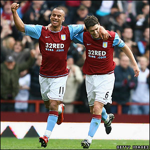 Agbonlahor and Barry celebrate the second goal
