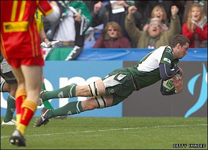 London Irish flanker Declan Danaher dives over for a try in the first half