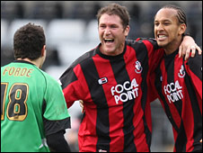 Bournemouth goalkeeper David Forde celebrates with Lee Bradbury and Joshua Gowling