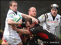 Shane Williams is tackled by Hugh Vyvyan and Richard Hill
