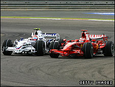 Kimi Raikkonen's Ferrari heads Robert Kubica's BMW Sauber early in the Bahrain Grand Prix