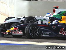 Jenson Button's Honda hits David Coulthard's Red Bull during the Bahrain Grand Prix
