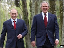 Vladimir Putin and George W Bush walk to joint news conference