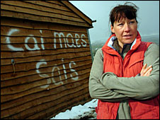 Alison Hayes standing next to a stables daubed with anti-English graffiti