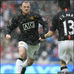 Rooney celebrates making it 2-2