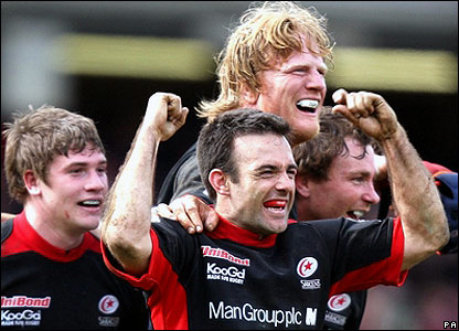 Saracens players celebrate the final whistle at Vicarage Road