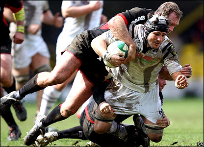 Man-of-the-match Richard Hill tackles Ospreys flanker Marty Holah