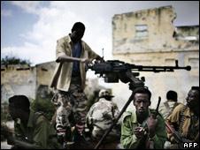 Somali soldiers sit on a vehicle at Bakara market, December 2007