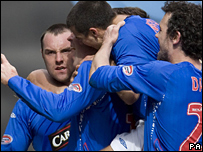 Kris Boyd and team-mates celebrate