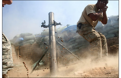 US mortar team fires from mountain outpost