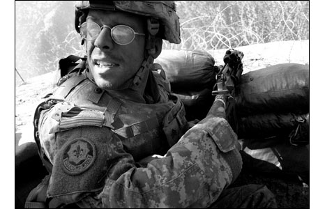 US soldier in sandbag position