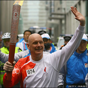 Duncan Goodhew waves to the crowd