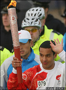 Walcott waves to the crowd in Greenwich