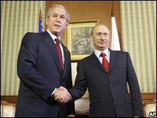 George W Bush and Vladimir Putin shake hands in Sochi - photo 6 April