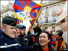 A Pro-Tibet activist is held by French police during a protest in front of the Chinese embassy in Paris (16 March 2008).