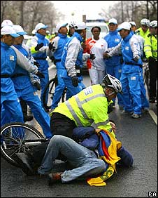 A Tibet protester tries to block the Olympic torch relay in London 6/4/08
