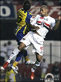 Adriano (right) heads the ball to score in the final minute against Sportivo Luqueno,