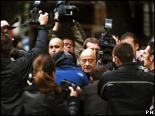 Mohammed Al Fayed surrounded by photographers