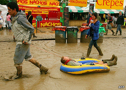 Woman being dragged through mud